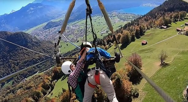 This man realized his hang-glider pilot forgot to attach him